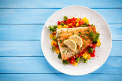 Roast fish fillet. Fish dish - fish fillet and vegetables royalty free stock images
