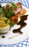 Roast Goats Cheese and Parma Ham. An appetizer of roast organic goats cheese and Parma Ham (Proscutto Di Parma Royalty Free Stock Photography