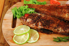 Roast golden fish Stock Images