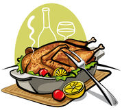 Roast goose. With a lemon and tomatoes Royalty Free Stock Photography