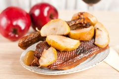 Roast goose with apple Royalty Free Stock Image