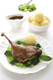 Roast goose with side dishes, elevated view Stock Photo
