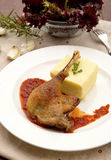 Roast goose. With tomato sauce and garlic, served with mashed potatoes h Royalty Free Stock Photo