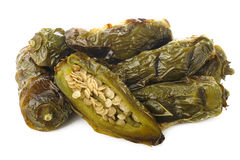 Roast green jalapeno peppers on white Stock Image