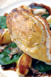 Roast Guinea Fowl. On a bed of gently roasted potato, spinach and diced bacon Stock Photo