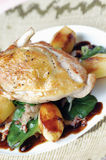 Roast Guinea Fowl. On a bed of gently roasted potato, spinach and diced bacon Stock Image