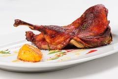 Roast half of duck with caramelized lemon Royalty Free Stock Photo