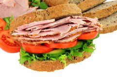 Roast Ham And Salad Sandwich. Roast ham and salad filled sandwich isolated on a white background Royalty Free Stock Photos
