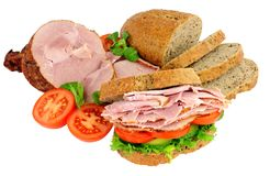 Roast Ham And Salad Sandwich. Roast ham and salad filled sandwich isolated on a white background Royalty Free Stock Photography