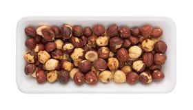 Roast hazelnuts in package Stock Photo