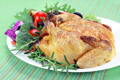 Roast hen on serving platter. Stock Photos