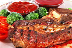 Roast juicy fat steak and hot sauces Royalty Free Stock Photography