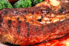 Roast juicy fat steak and hot sauces Stock Photo