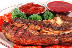 Roast juicy fat steak and hot sauces Stock Image