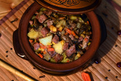 Roast `Kirsani` with mushrooms and beans Stock Photography