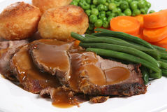 Roast Lamb. Traditional Sunday roast lamb dinner with roast potatoes and vegetables Royalty Free Stock Photography