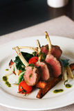 Roast lamb. Chop with steamed vegetables and potatos Royalty Free Stock Images