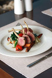 Roast lamb. Chop with steamed vegetables and potatoes and pasta stock photo