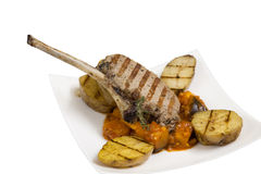 Roast lamb on the bone with potatoes Royalty Free Stock Photo