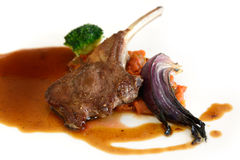 Roast lamb chops with gravy on white background Stock Images
