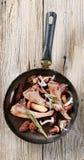 Roast lamb chops and mushrooms Stock Photo