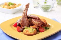 Roast lamb chops and potatoes Royalty Free Stock Images
