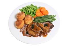 Roast Lamb Dinner. Traditional British Sunday roast lamb dinner with gravy and mint sauce Stock Photography