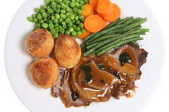 Roast Lamb Dinner. Traditional Sunday roast dinner with lamb and mint sauce Stock Photo