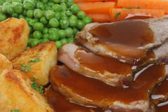 Roast Lamb Dinner. Close-up of traditional Sunday roast lamb dinner with gravy Stock Image