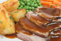 Roast Lamb Dinner. Traditional Sunday roast dinner with lamb, potatoes and vegetables Stock Image