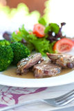 Roast lamb with gravy Royalty Free Stock Photography