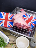 Roast lamb joint with english flags Stock Images