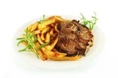 Roast lamb with potatoes Stock Photo