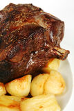 Roast lamb and potatoes Stock Photo