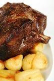 Roast lamb and potatoes Stock Photo