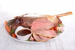 Roast lamb. And sauce on plate Royalty Free Stock Image