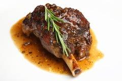 Roast Lamb Shank. Slow roasted lamb shank with an onion jus Stock Photo