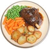 Roast Lamb Shank Dinner royalty free stock image