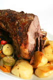 Roast lamb and veg. Herbed roast lamb with roast potatoes and stir-fried vegetables Royalty Free Stock Photos