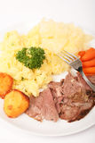 Roast lamb and vegetable dinner vertical Stock Photography