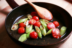 Roast leek and tomatoes. In frying pan Royalty Free Stock Image