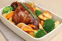 Roast Leg of Lamb. With roast potatoes, parsnips, broccoli and carrots Stock Images