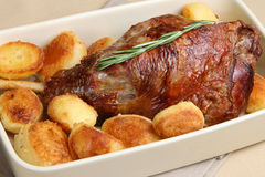 Roast Leg of Lamb with Potatoes Stock Photo