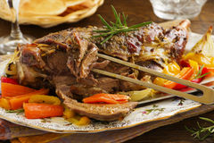 Roast leg of lamb with rosemary and garlic Royalty Free Stock Photos