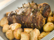 Free Roast Leg Of Lamb Studded With Rosemary And Garlic Royalty Free Stock Photos - 5951238