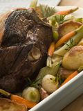 Roast Leg of Spring Lamb With Roast Potatoes Stock Photography