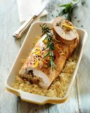 Roast loin of pork stuffed with mushrooms and barley. stock photography