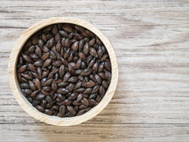 Roast malt on wooden background Royalty Free Stock Photos