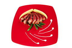 Roast meat with corns Royalty Free Stock Image