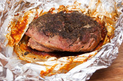 Roast meat in foil Royalty Free Stock Photos